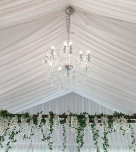 Chandelier in marquee with silk lining